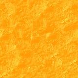 Yellow stucco seamless background. Stock Photography