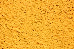 Yellow stucco texture royalty free stock photography