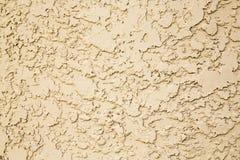 Yellow stucco wall Stock Photo