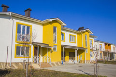 Yellow style house with court Stock Image