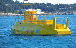 Yellow submarine. Anchored in the blue bay Royalty Free Stock Photos