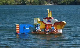 Yellow submarine themed milk carton boat. Seattle Seafair milk carton derby boat races,  Seattle, Washington, people make water Royalty Free Stock Photography