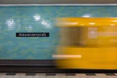 Yellow subway train in motion on Berlin Alexanderplatz underground station. Stock Images