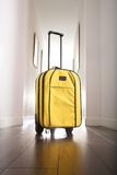 Yellow suitcase at hall house Royalty Free Stock Image