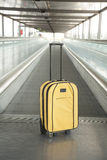 Yellow suitcase at walkway Stock Photos