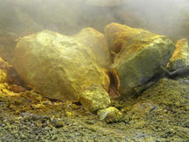 Yellow sulfur crystal deposit in volcanic crater Royalty Free Stock Images