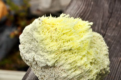 Yellow Sulfur crystals. On rocks Royalty Free Stock Photography