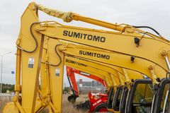 The yellow Sumitomo excavators are lined up in a single line. royalty free stock photo