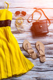 Yellow summer dress and sandals. Royalty Free Stock Image