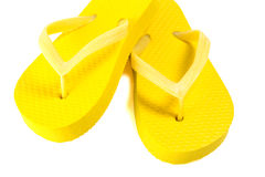 Yellow summer flip flop shoes isolated on white Stock Photo