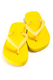 Yellow summer flip flop shoes over white Royalty Free Stock Image