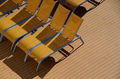 Yellow sun loungers on cruise ship Royalty Free Stock Photo
