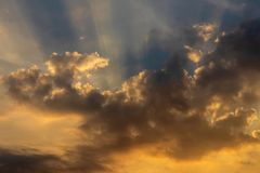 The yellow sun shines through the clouds royalty free stock photo