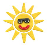 Yellow sun with smile in black sunglasses. Plasticine. Isolated on a white background. The concept of children`s creativity or sunny weather Stock Photo