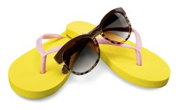 Yellow flip flops and sunglasses on white Royalty Free Stock Photography