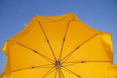 Yellow sun umbrella. Against blue sky Royalty Free Stock Photos