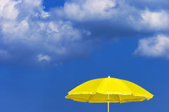 Yellow sun umbrella Stock Image