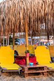 Yellow Sunbeds on the Beach with Umbrellas - Nea Vrasna, Greece royalty free stock images