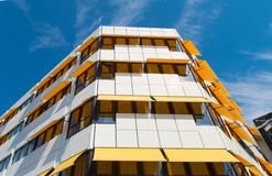 Yellow sunblinds. White building with yellow sunblinds Royalty Free Stock Photography