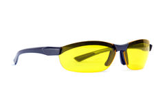 Yellow sunglasses. Angle view. Yellow sunglasses Isolated on white stock photo