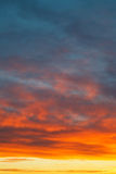 Yellow sunrise clouds under blue morning sky Stock Photography