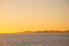 Yellow sunset and ferry Stock Photos