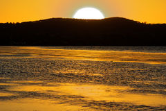 Yellow sunset lake and sky Royalty Free Stock Image