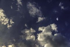 yellow sunset with moon and clouds royalty free stock photo
