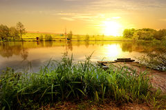 Yellow sunset on pond Royalty Free Stock Image