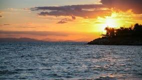 yellow sunset on Saronic Gulf of Aegean Sea Stock Photography