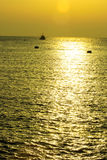 Yellow sunset on sea Stock Image