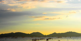 Yellow sunset with sea. Night landscape at sunset sea thailand songkhla traval Stock Photo
