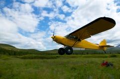 Yellow Super Cub bush plane taking off Stock Image