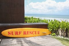 Yellow surf rescue board by the sea Stock Images