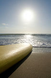 Yellow surfboard on the beach Royalty Free Stock Photo