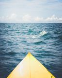 Yellow surfboard on the sea. Summer season. Vintage effect color filter stock photos