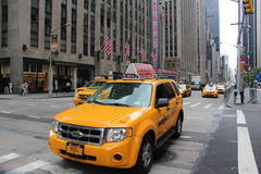 Yellow SUV taxi cab Stock Photos