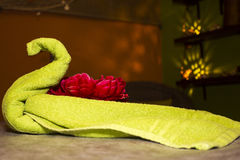 Yellow swan made of towels. Red flower. Spa-salon. Relax. luxury Royalty Free Stock Photo