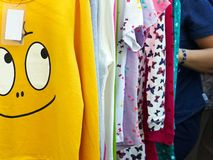 Yellow sweatshirt with a positive, smiling face royalty free stock photography