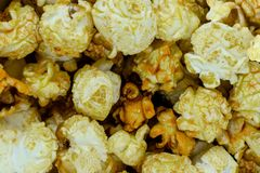 Yellow and Sweet Caramel Popcorn background Surface royalty free stock photos