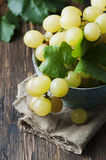 Yellow sweet grape on the wooden table Stock Images