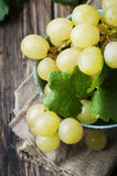Yellow sweet grape on the wooden table Stock Photos