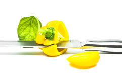 Yellow Sweet Pepper  with Knife Isolation Stock Images