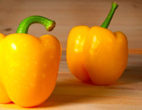Yellow sweet pepper on wooden background Stock Photography