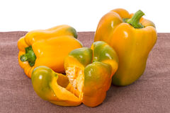 Yellow sweet peppers on a fabric Royalty Free Stock Photos