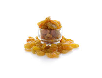 Yellow sweet raisins on white Stock Photography