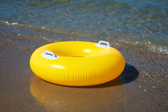 Yellow swim ring floating Royalty Free Stock Images