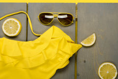 Yellow swimsuit one-piece, aviator sunglasses Stock Photography