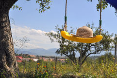 Yellow swing,2. A yellow swing hanging on a tree  on a beautiful sunny day,blue sky Stock Image