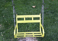 Yellow swing in the park Stock Image